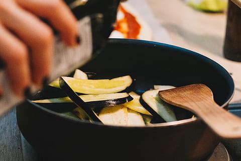 person-cooking-on-black-pot-thumbnail 1